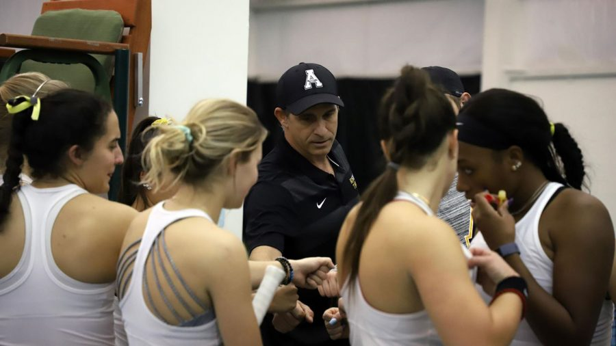 The App State womens tennis team huddles in preparation for a match. The team won the Sun Belt Conference regular season championship for the first time in program history.