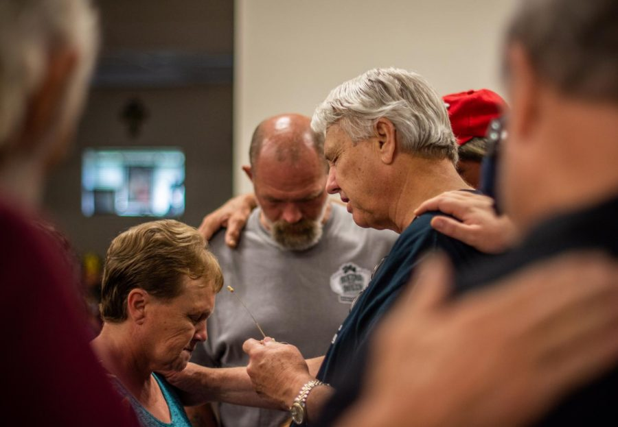 Pastor Alan Rice starts off every Sunday service at Crossfire with a group prayer, where churchgoers may receive words from Pastor Rice himself, as well as the blessings of others in the group standing with them.