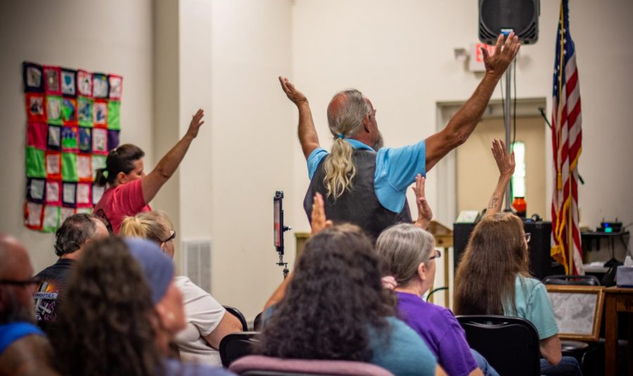 Members of Crossfire United Methodist Church stand and revel during CJ Ballard's performance. The songs elicited emotional and passionate responses out of churchgoers, which the church welcomes.
