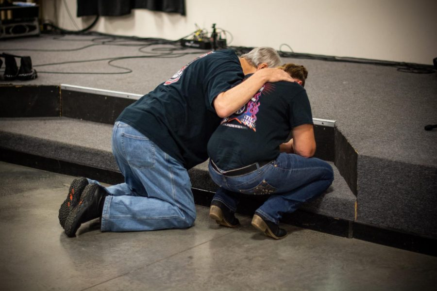 Alan Rice consoles BJ Werner, who came forward to the stage to pray and grieve during one of CJ Ballard's songs. Werner spoke a lot about her struggles but how the church is helping her grow significantly.