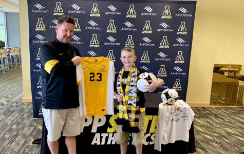 Jacob Brown poses with men's soccer head coach Jason O'Keefe after signing with the Mountaineers on August 15. Photo courtesy of App State Athletics
