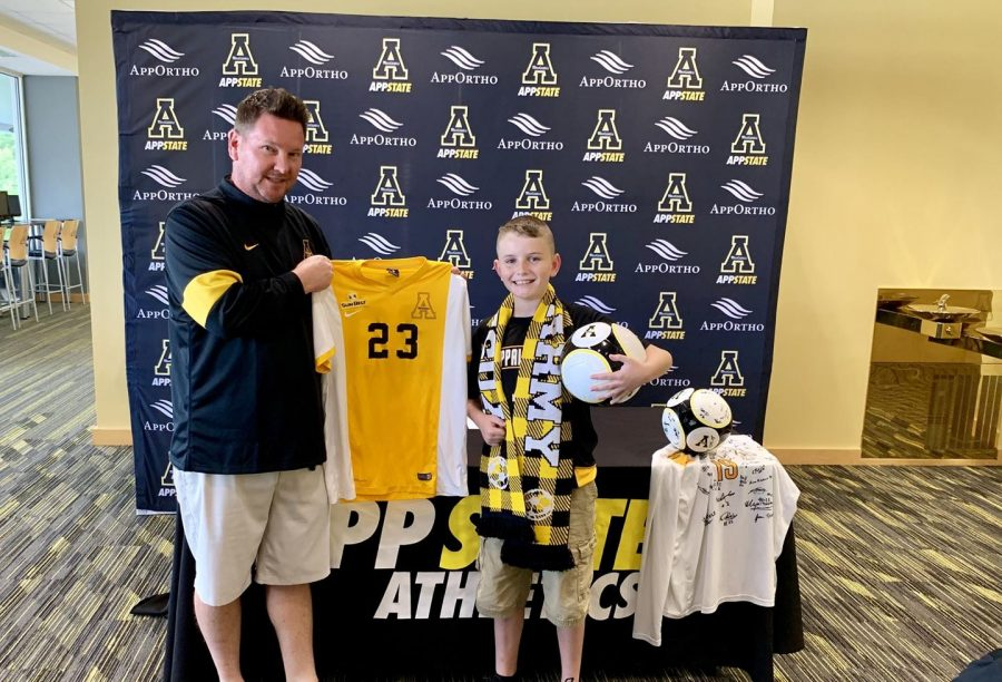 Jacob+Brown+poses+with+men%27s+soccer+head+coach+Jason+O%27Keefe+after+signing+with+the+Mountaineers+on+August+15.+Photo+courtesy+of+App+State+Athletics