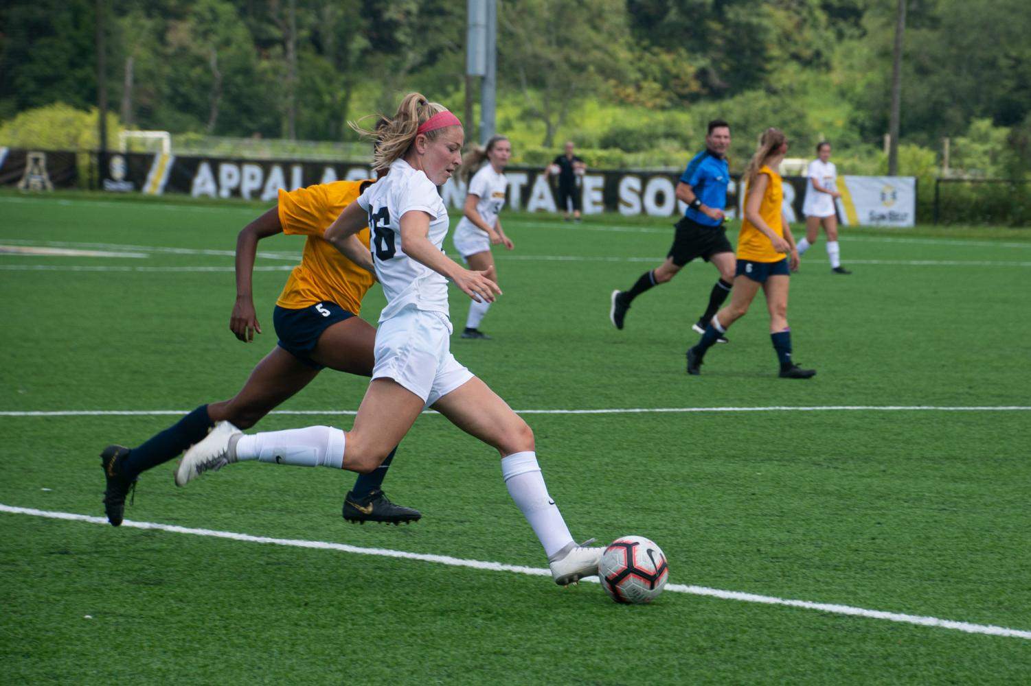 Freshman midfielder Hayley Boyles makes a play in the Mountaineers exhibition game against East Tennessee State on August 16. Photo by Lynette Files