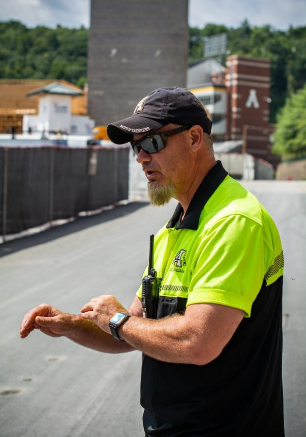 Jim Prophet with App State Parking directed traffic and parking flow in front of Eggers Hall and the new parking deck on Friday. Prophet talked about how essential the new parking deck was in keeping traffic flow efficient.