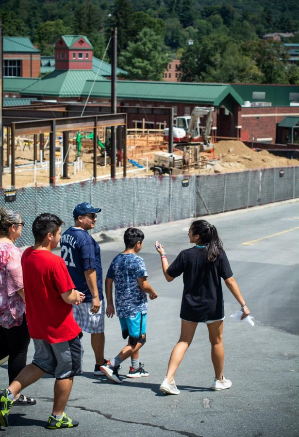 Incoming freshman exercise science major Rachel Luna and her family walk to get more supplies for her new dorm room. According to the family, it took them an hour to get up Stadium Drive to unload Luna's stuff at Eggers Hall.