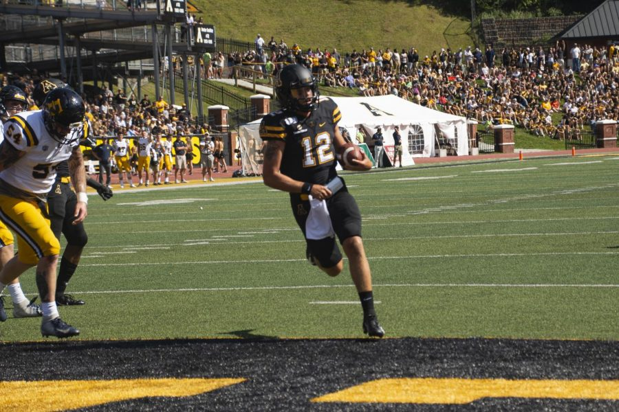 Junior quarterback Zac Thomas scores a touchdown in App State's 42-7 win over East Tennessee State on Aug. 31.
