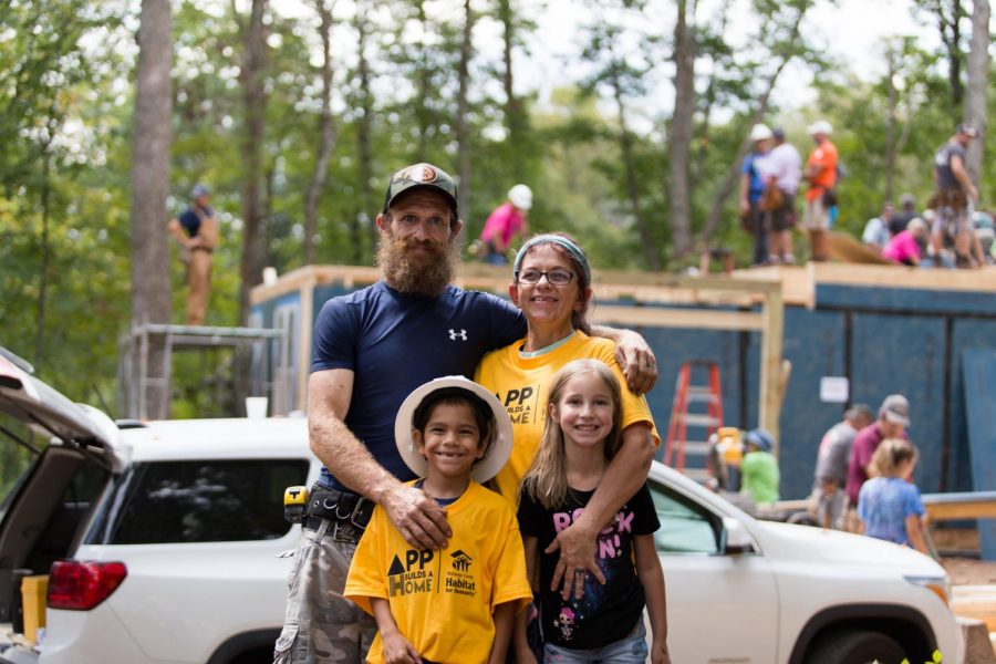 The Barker Family stands on site as their future home is built by volunteers. The family was chosen by the Watauga Habitat for Humanity to receive this new home as apart of the Blitz Build.