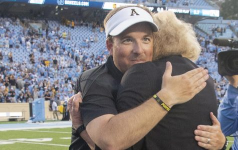 Former head coach Eliah Drinkwitz embraces App State chancellor Sheri Everts after defeating UNC.