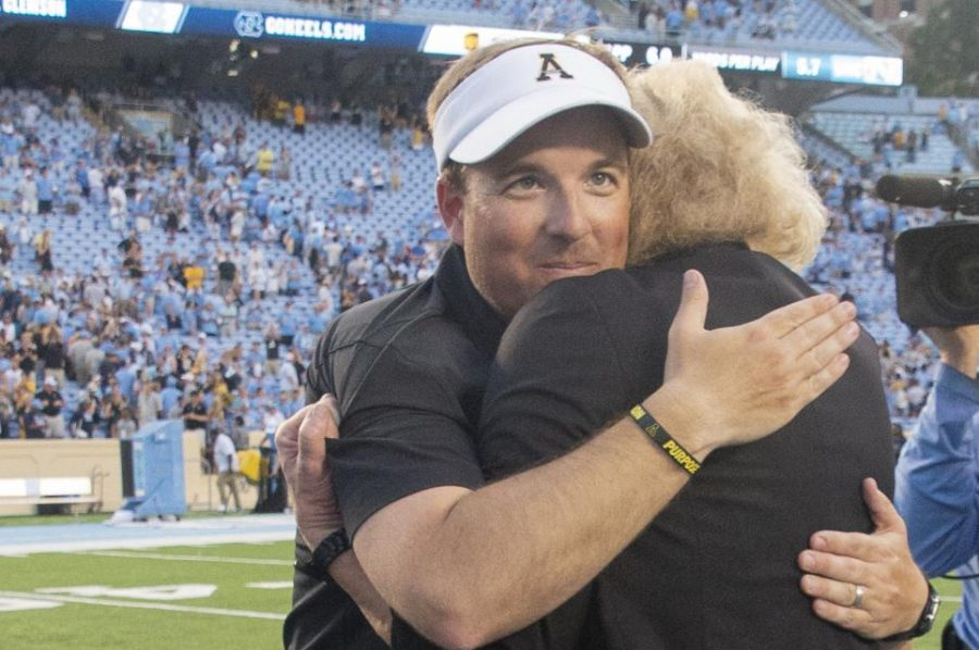 Former+head+coach+Eliah+Drinkwitz+embraces+App+State+chancellor+Sheri+Everts+after+defeating+UNC.+