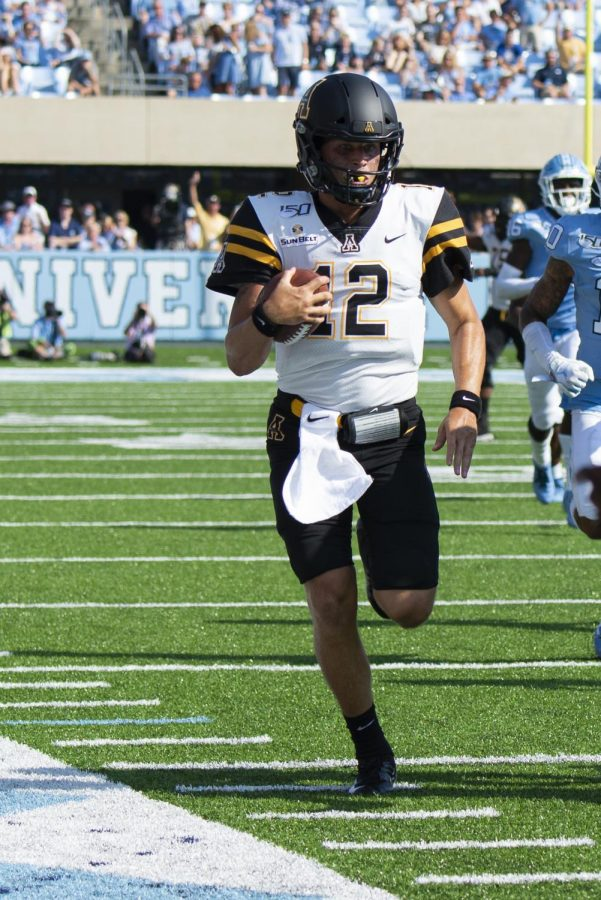 Junior Quarterback Zac Thomas runs in a 34-31 win over UNC. Thomas finished the game with 56 yards rushing on six carries.