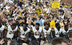App State players celebrate with fans after last year's win over UNC. Despite a push for the families of players to be allowed, Kidd Brewer Stadium will be empty for at least the first two home games.
