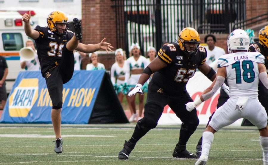 Junior center Ivan Reyes (right) is one of the many walk-ons for App State football this season. Reyes redshirted his freshman year and has appeared in five games since 2017, including Saturday's win against Coastal Carolina.