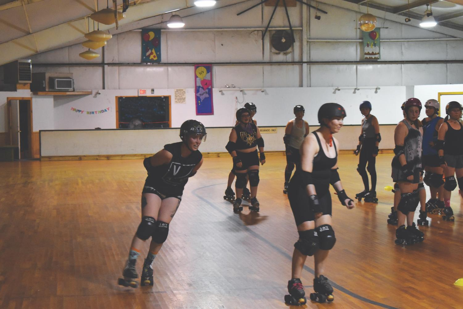 Members of the Appalachian Roller Derby skate around during a recent practice session.
