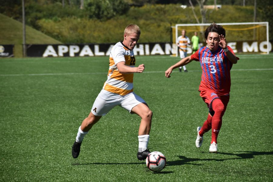 Sophomore forward Kelan Swales zooms past a defender from American. The men's soccer team is currently 2-1 for the season after Sunday's victory.