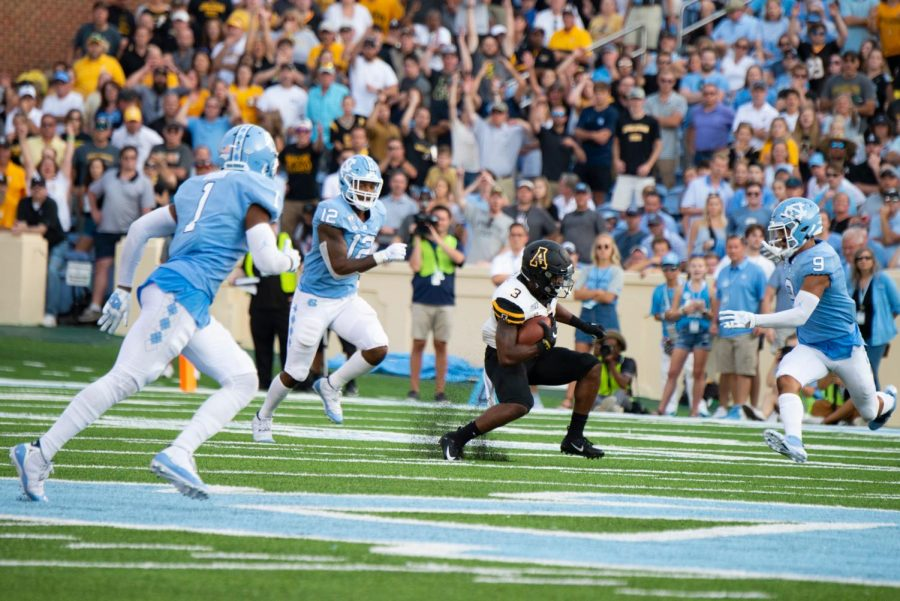 Junior RB Darrynton Evans makes a cut during the 34-31 win over UNC in Chapel Hill Sept. 21.