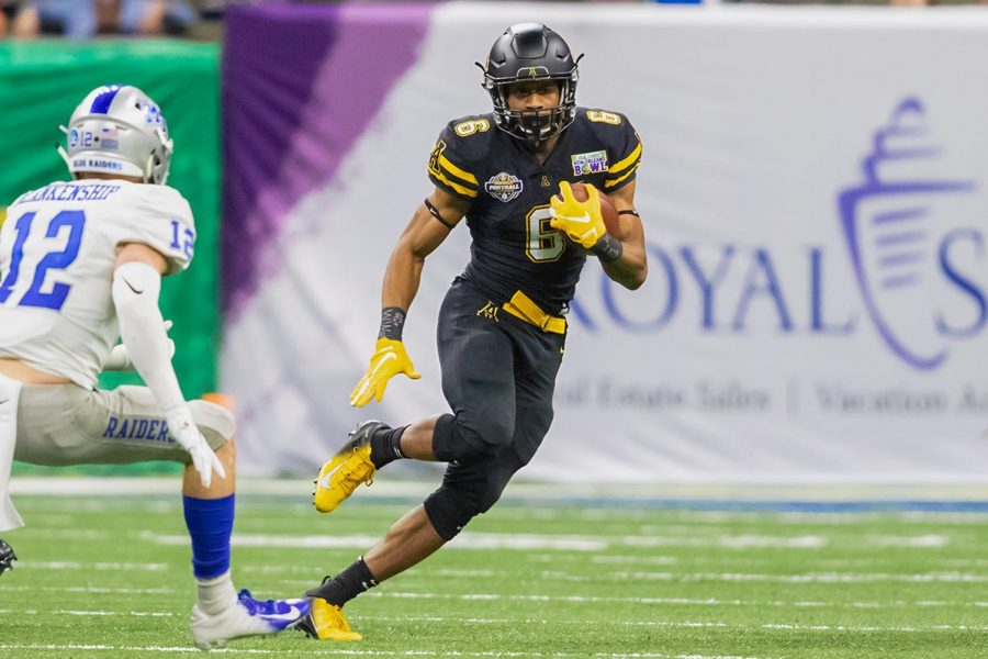 Redshirt freshman Camerun Peoples gets a carry in App State's 45-13 win over Middle Tennessee State in last year's R+L Carriers New Orleans Bowl. // Photo courtesy of App State Athletics, Jonathon Aguallo