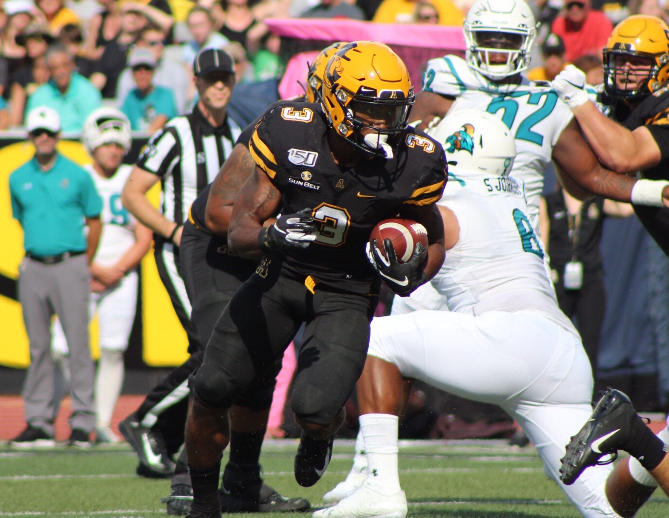 Junior running back Darrynton Evans runs with the ball during the first quarter of App State's matchup with Coastal Carolina on Sept. 28.