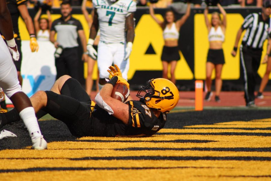 Senior tight end Collin Reed holds onto the football after catching an 11-yard touchdown pass in the first quarter against Coastal Carolina on Sept. 28.