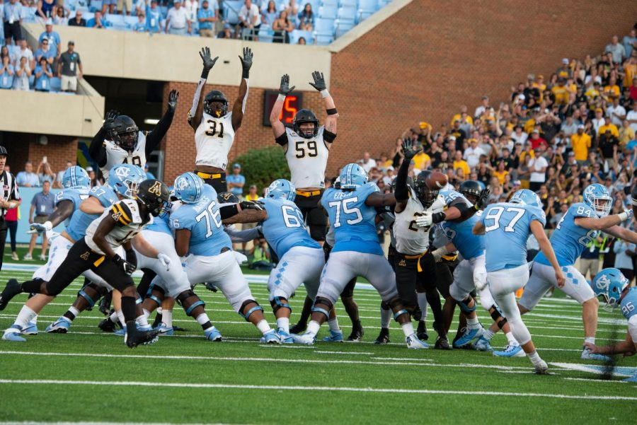 Senior linebacker Jordan Fehr and redshirt freshman outside linebacker Nick Hampton jump to block a field goal on the final play of the game to seal the 34-31 victory for the Mountaineers.