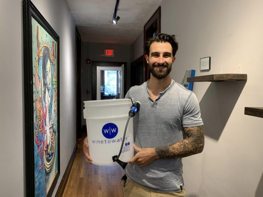 Josh Elliott, director of international programs for Wine to Water, holds one of the filters his organization donated to The Bahamas