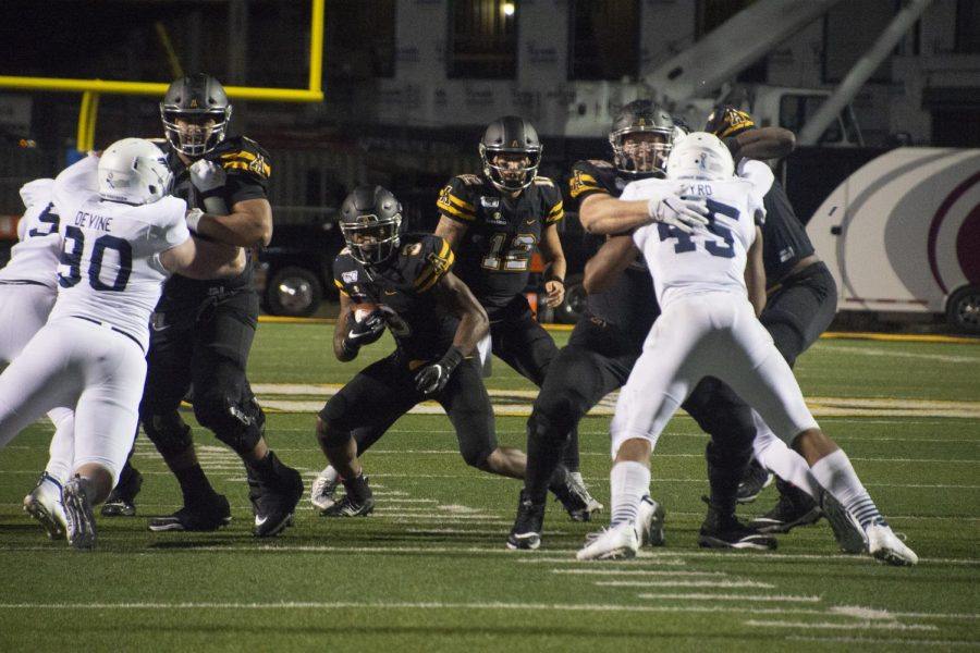 Junior running back Darrynton Evans attempts to hit a gap in App State's 24-21 loss against Georgia Southern on Oct. 31.