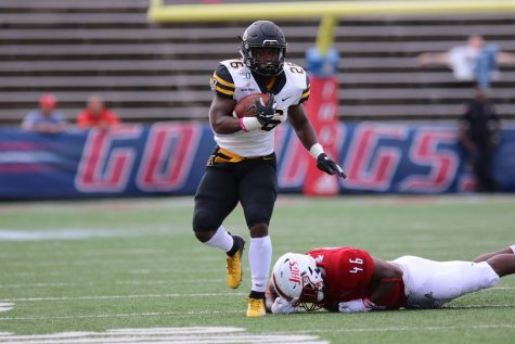 Running back Daetrich Harrington out for season with left foot injury