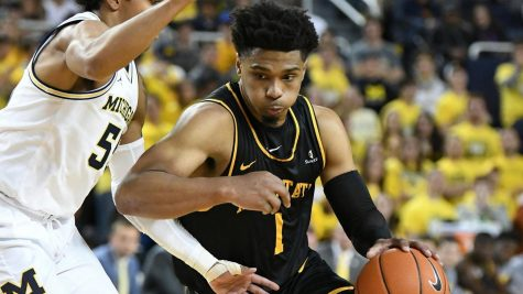 Junior guard Justin Forrest drives in App State