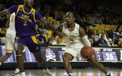 Guard O'Showen Williams drives during App State's 68-62 win over East Carolina on Nov. 12. Williams and teammate Isaac Johnson inked pro deals with European teams this week.
