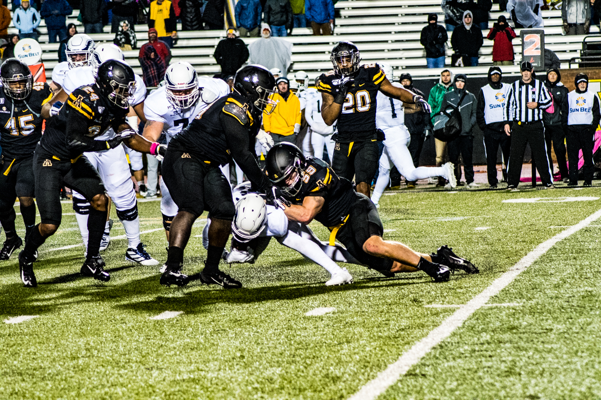 Senior captain and linebacker Jordan Fehr helps make a tackle in App State's 24-21 loss to Georgia Southern on Oct. 31.