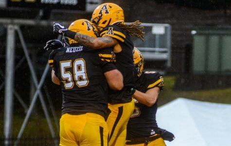 Junior WR Corey Sutton celebrates his touchdown in the first quarter with teammates. App State went on to beat Texas State 35-13 on Nov. 23.