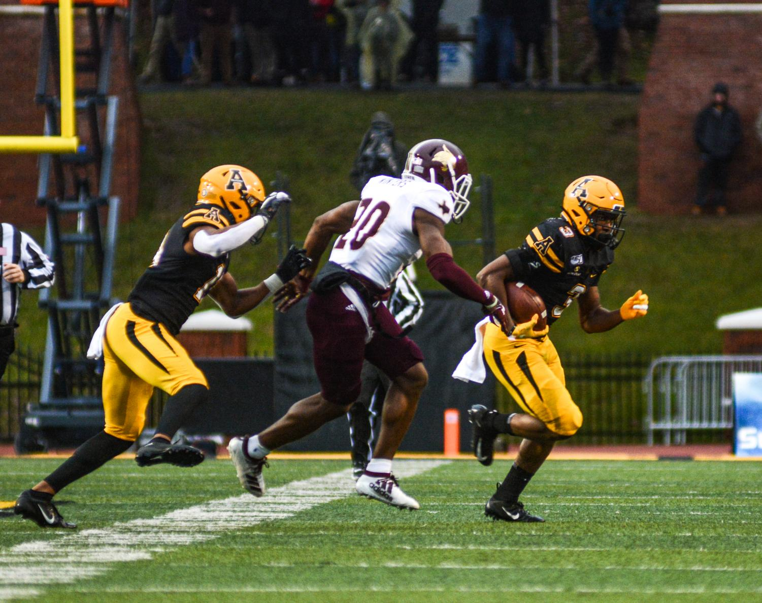 Junior running back Darrynton Evans looks for a hole during App State's 35-13 win over Texas State on Nov. 24.