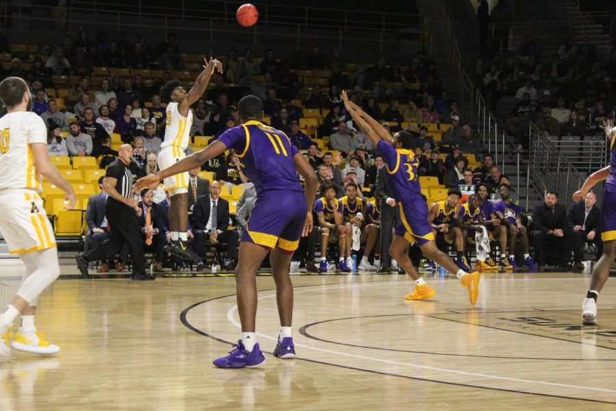 Sophomore guard Adrian Delph knocks down a three pointer in the first half of App State's 68-62 win over East Carolina on Nov. 13. Delph set new career-highs with 19 points and nine rebounds in the game.