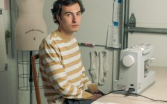 Austin Juno, an apperal design major, sits in his home studio in Boone. He started his fashion brand,