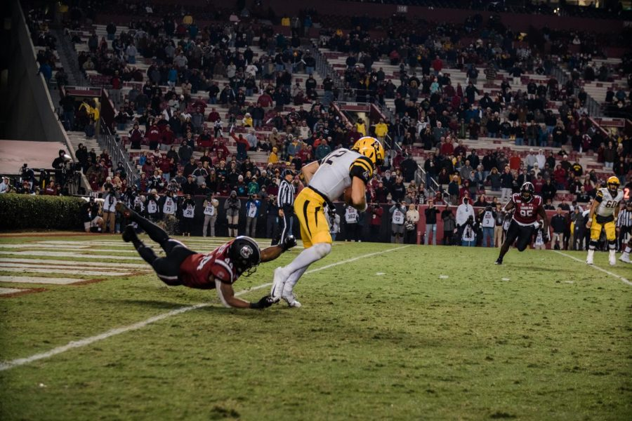 Junior quarterback Zac Thomas escapes a defender near his own end zone against USC.