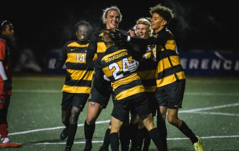 Members of App State's soccer team celebrate after a goal from junior midfielder/forward Marc Pfrogner (#24).