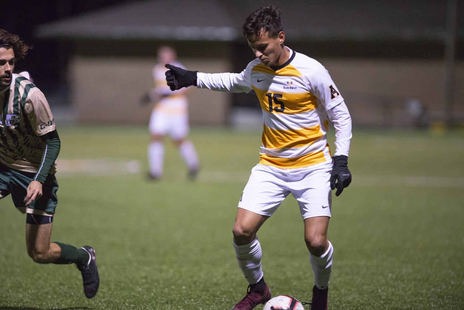 Sophomore midfielder Dimitris Moraitakis dribbles the ball during App State's 4-2 loss to Coastal Carolina on Oct. 19. Moraitakis has goal and has started 10 games this year.