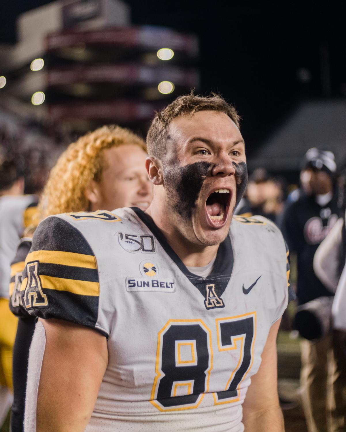 Senior tight end Collin Reed celebrates the 5-point victory over his hometown team on Nov. 11