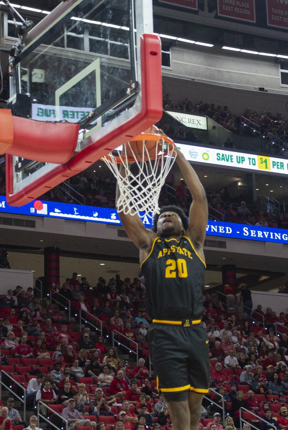 Sophomore guard Adrian Delph dunks in App State's loss at NC State on Dec. 29. Delph recorded his first career double double in the loss to Georgia State on Thursday.