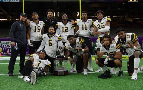 Members of the App State defense celebrate the victory against UAB at the New Orleans Bowl Dec. 21.