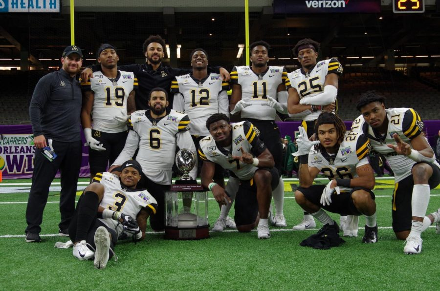 Members+of+the+App+State+defense+celebrate+the+victory+against+UAB+at+the+New+Orleans+Bowl+Dec.+21.+