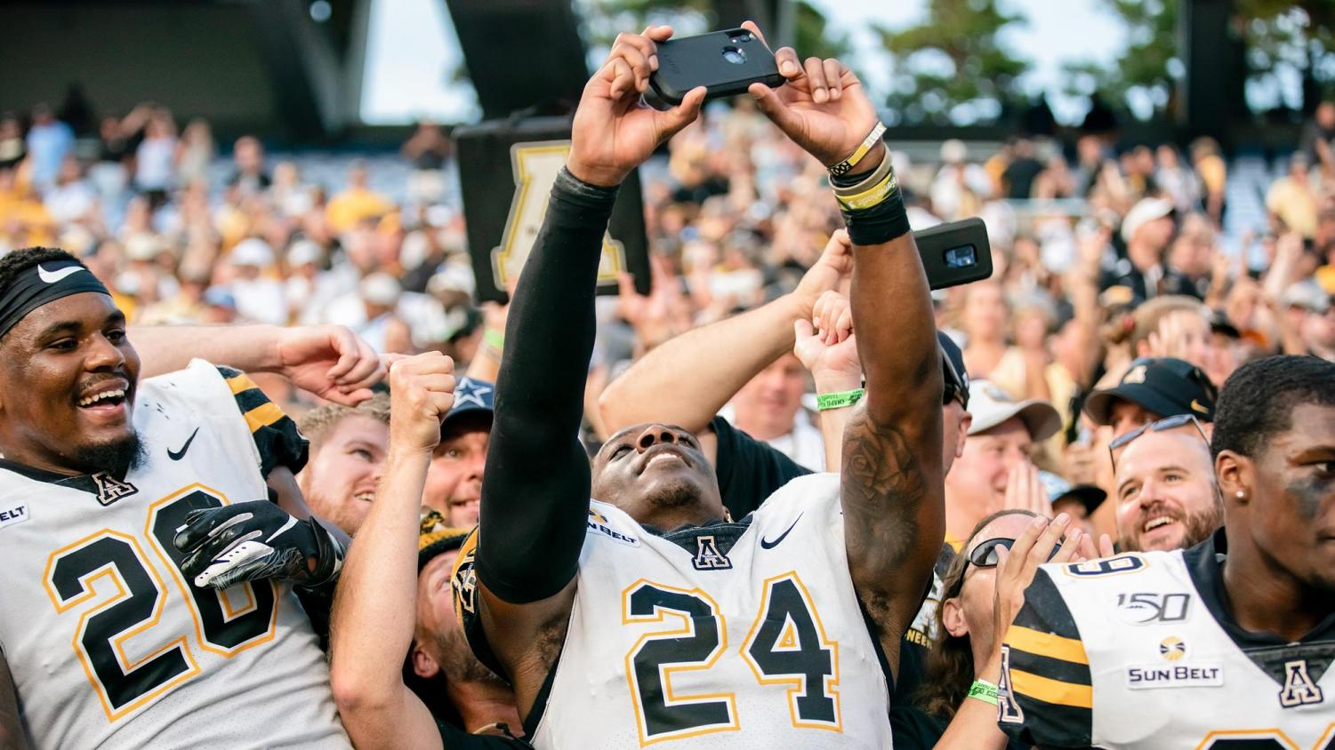 Akeem Davis-Gaither snaps a pic with fans after App State's 33-30 win over North Carolina on Sept. 21.