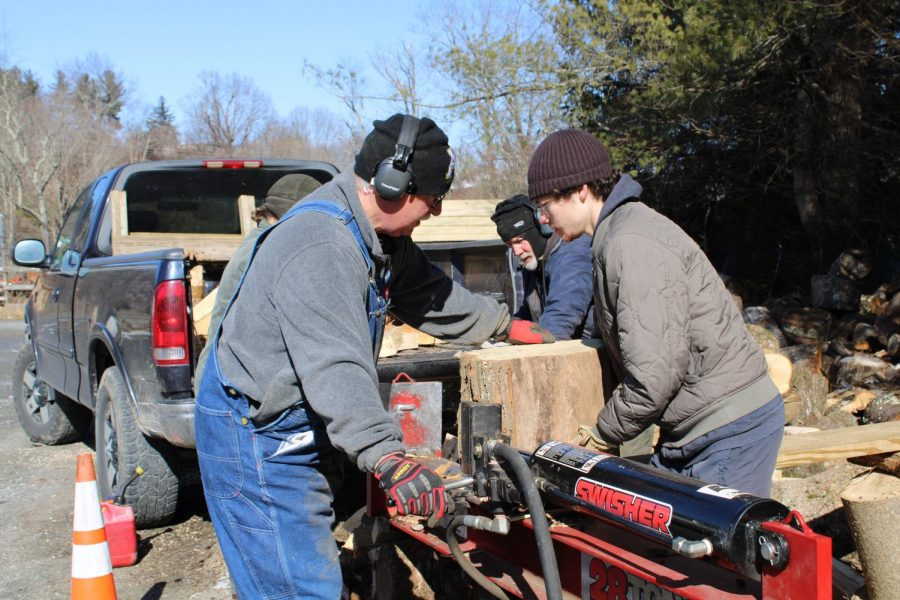 Volunteers, including senior social work major Larry Lapushin, chop wood for Hospitality House, one of several community partners for this years MLK Challenge.