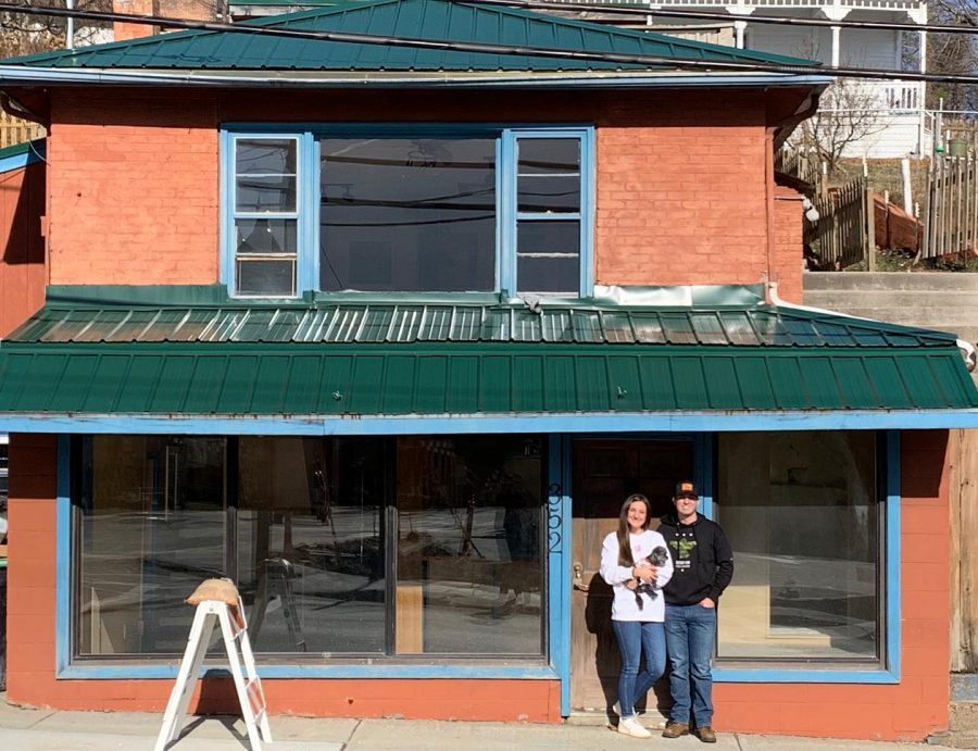 The Northerns stand in front of the new location of Blue Deer on King located next to Fruits, Veggies, and More.