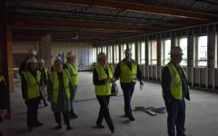 University officials make their way through Sanford Hall as it currently stands on Feb. 19. Nick Katers, associate vice chancellor for facilities management, said that the building already had a good structure and base and that