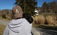 After an afternoon of fetch in Durham Park, 4-month-old Severus and his owner take a moment to embrace. Like many emotional support animals, Severus enjoys spending time and comforting their owner.
