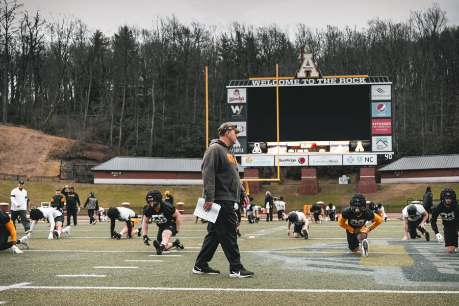 App+State+head+coach+Shawn+Clark+watches+his+team+stretch+during+the+first+week+of+spring+practices.+