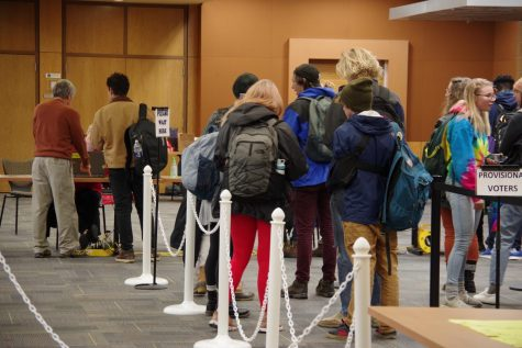 Voters stand in line to vote at the voting site in the Plemmons Student Union voting site on Super Tuesday March 2020.