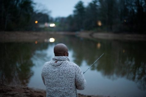 """James Murdock of Granite Falls fishes as the sun sets in Caldwell County. """"I'm not gonna let anything stop me from fishing. I love to fish,"""" he said."""