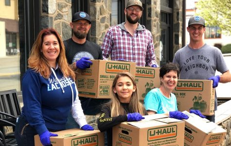 Ransom Pub Managing Partner Todd Hendley (third from left), brother Doc Hendley (second from left) and others help the pub package care boxes for the High Country's service industry workers.