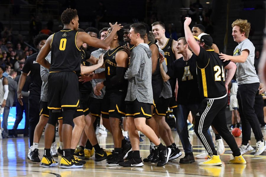 Fist team all-Sun Belt junior guard Justin Forrest celebrates with his teammates after hitting the game-winning three in App State's 74-72 win over Georgia Southern Jan. 4.